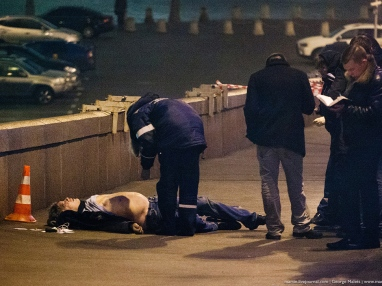 Russian police investigate the the body of Boris Nemtsov, a former Russian deputy prime minister and opposition leader at Red Square in Moscow, Russia, Saturday, Feb. 28, 2015. Russia's Interior Ministry says Boris Nemtsov, a leading opposition figure and former deputy prime minister, has been shot and killed near the Kremlin. Nemtsov, a sharp critic of President Vladimir Putin, was killed early Saturday. His death comes just a day before a major opposition rally in Moscow. (AP Photo/George Malets)